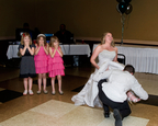 Little girls giggle at bride & groom