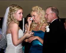 Bride, dad and sister with tears of joy